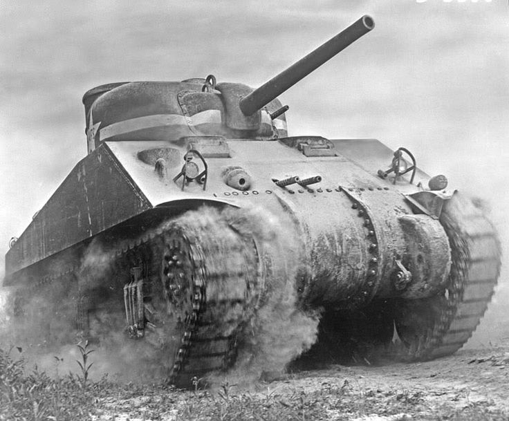 Sherman Tank, an early version. The center hull fixed mount twin machine guns were dropped on later models.