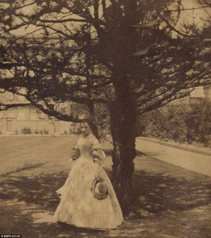In 1859, the family acquired a new London home at 5 Princes Gardens in South Kensington, London, where an unidentified model poses (above)