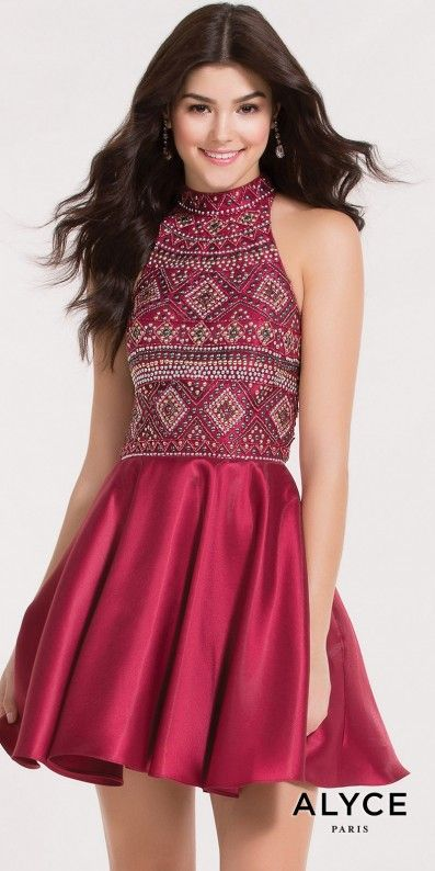 Step away from your comfort zone and wow the crowd in this Aztec Studded Illusion Racer Back Cocktail Dress by Alyce Paris. This alluring ensemble features a high collar neckline with a Mikado fit and flare silhouette. The bodice is adorned with an array of multi color studs to create a beautiful Aztec print while the back includes a upper racer with illusion and a lower cut out for the perfect hint of skin to show. #edressme