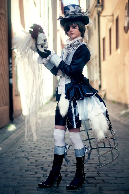 [my jaw dropped, I'm in love with this outfit.  except the eye patch...] I am pretty sure this is cosplay of Ciel from Black Butler, but it IS a great outfit