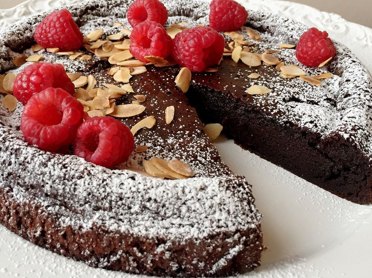 Flourless Chocolate Cake with Raspberries and Toasted Almonds, by @dvsbia001