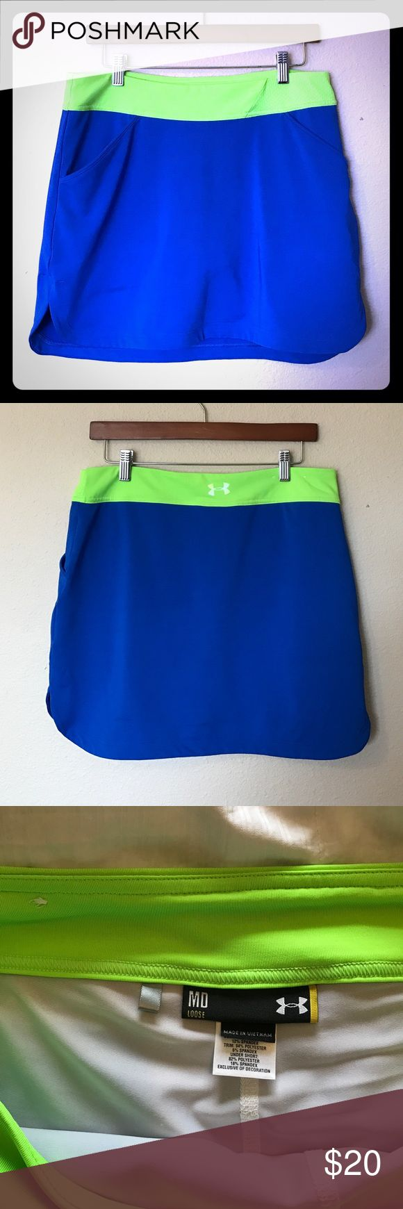 Under Armour Heat Gear workout skort skirt Under Armour Heat Gear workout skort (skirt with attached compression shorts). 2 pockets in front. EUC, no stains, rips or holes. I also have a matching Under Armour collared muscle tee in my closet for sale! Bundle and save! Under Armour Shorts Skorts