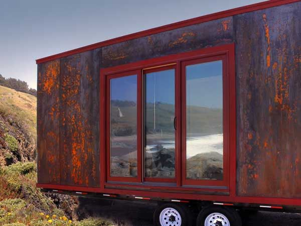 The Popomo is sleek, simple and Tumbleweed's easiest house to build. The hot rolled corrosion resistant steel siding separates this house from anything else on the road. At 8 feet - 6 inches wide, it maximizes road width without requiring a special permit to tow. Weighing approx 7500 lbs, it's towed easily by full sized trucks. Step inside this 172 square foot house on wheels and you'll find all the necessities you need.     http://www.tumbleweedhouses.com/products/popomo/#ad-image-0