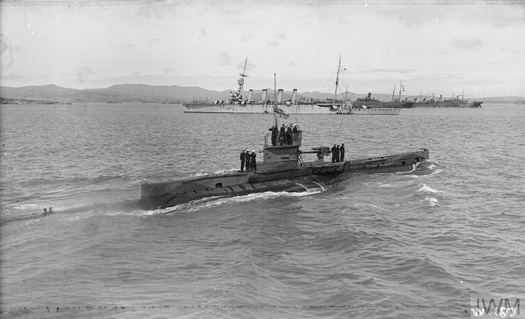 HM sub E11, with HMS Lowestoft in the background.