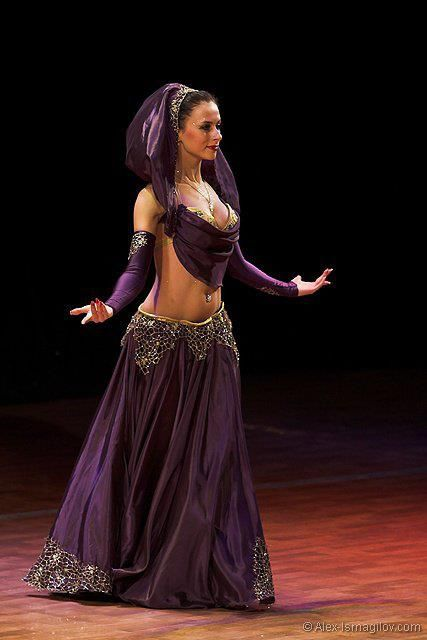 Beautiful brlly dancer in purple costume