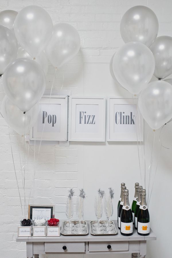 NYE bar table // photo by Scarlet O'Neill, event design by Ashley Lindzon Events - view more: http://ruffledblog.com/silver-wedding-anniversary-ideas/
