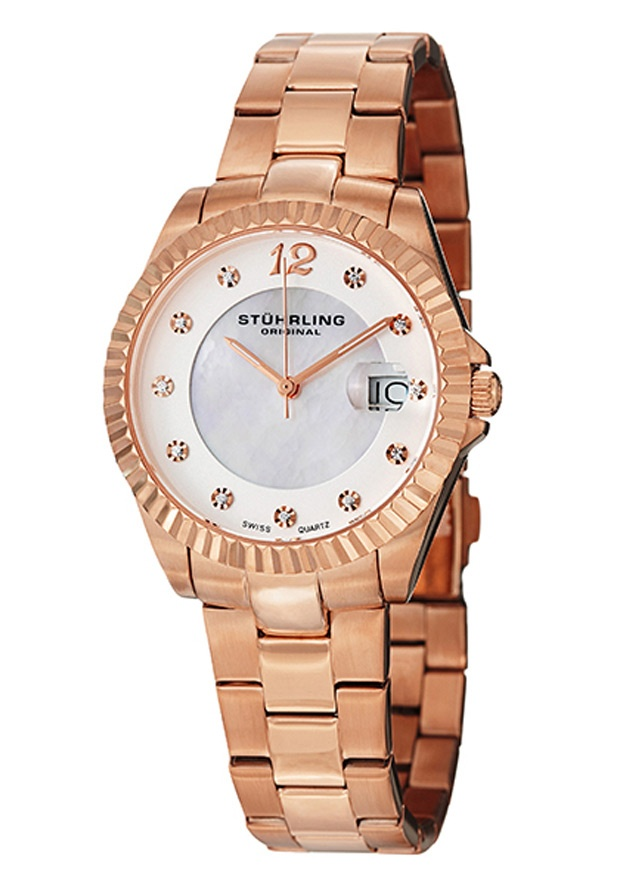 Stuhrling Original 498.11447, This stunning women's timepiece is elegant and classy. The watch features a mother of pearl inner dial and Swarovski crystal markers. A magnified date window displays at the 3 o'clock position. A stainless steel bracelet finishes off this timepiece.