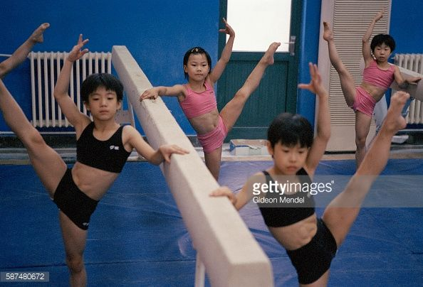 Young gymnast Zhao Chaoyue (8) takes part in strength, posture and endurance-building exercises during her daily training at the Shishahai Sports School. This is one of the most successful training venues in China, where young gymnasts and other sports trainees live and start intensive training from the age of five.