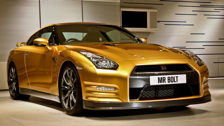 Front low profile passenger side view picture of the Nissan Motor Co., Ltd. unique 2013 Bolt-performance gold-painted GT-R which was auctioned on eBay Motors to benefit the Usain Bolt Foundation.