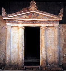 The Macedonian Tomb of Anthemia - Lefkadia Historical Macedonia, Greece.  This is a graceful, two-chamber monument with an Ionic facade of four semi-columns which support the entablature and the pediment. In the pediment's hollow, a semi-declining couple is depicted in fresco.