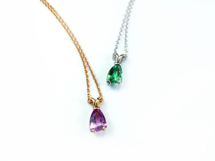 Sail pendants with pink sapphire and tsavorite garnet in Fairtrade white and rose gold #JonDibben #Fairtradegold #Fairtrade #sapphire #tsavorite