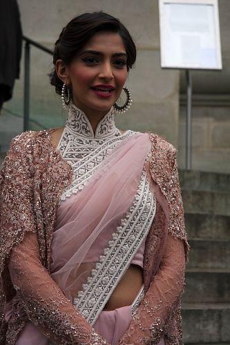 Sonam Kapoor wearing a rose white saree designed by Deepti Pruthi. i like the jacket IDEA