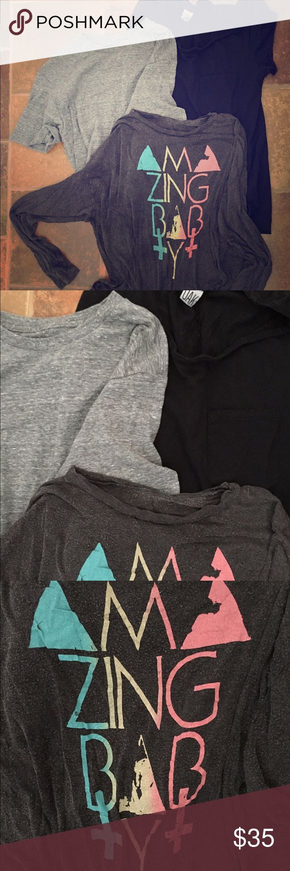 Oak NYC and Brandy Melville Tshirt Bundle Once you put on these super soft tees from the coolest cool girl stores of LA & NYC, you won't want to take them off! I ONLY buy tees that are super soft & have that lived-in look 😂 They pair well with anything in your closet, at that price you can't go wrong! Each tee has only been worn a few times so are in great condition! The heather grey is a drop Shoulder cropped tee, the black is just a simple tee, while the long sleeve is meant to have the…