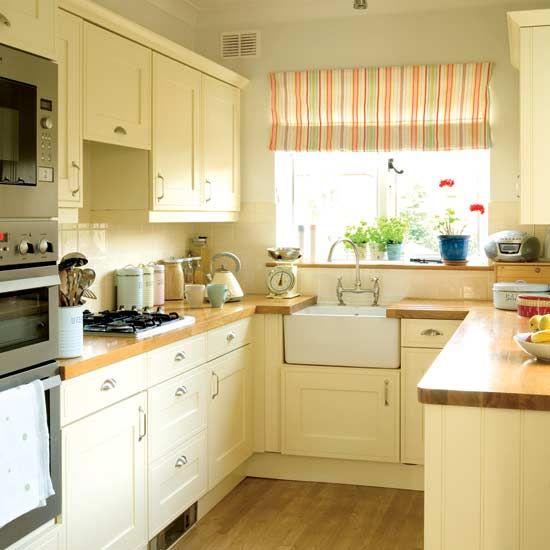 Cream Kitchen Cabinets, butcher block countertops