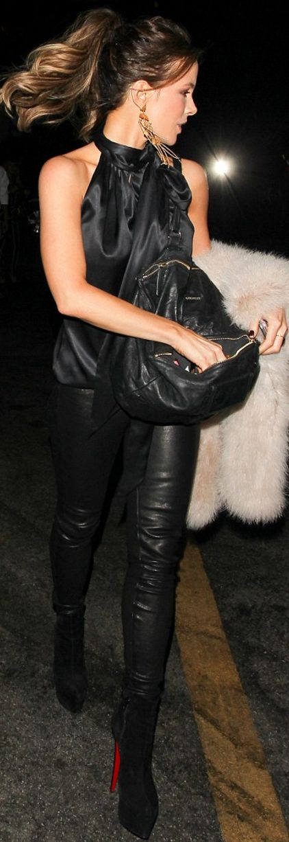 Who made  Kate Beckinsale's black suede ankle boots, satin tie top, leather pants, and handbag?