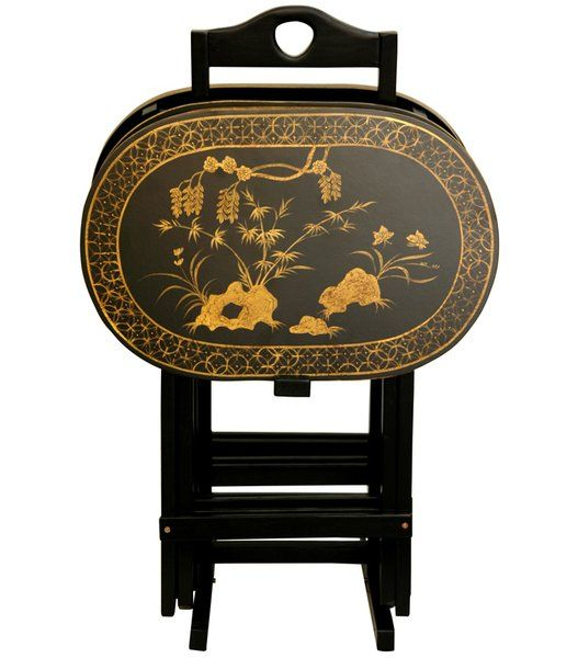 A beautifully crafted set of folding TV trays with a conveniently designed stand, hand painted with a lovely antiqued gold art motif over fine black lacquer. The hand painted art motif is a classic bamboo and butterfly design, creating distinctive, elegant table tops.