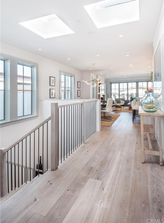 Cottage Hallway with Paint1, Walnut - Shell White 5 in. Engineered Hardwood Wide Plank, High ceiling, Hardwood floors