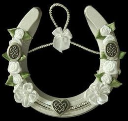 brides carry porcelain horseshoes (up!) during the wedding. Hang above the door of your home after your wedding to bring luck to your home...