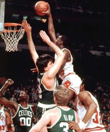 A very young Michael Jordan dunking on Kevin Mchale. Slam dunk photos. Best dunks on Pinterest. Dunk pics. #47straight #basketball  www.kingsofsports.com