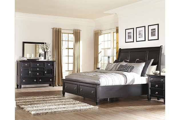 Crisp and clean. Dark and dramatic. The Greensburg bedroom set offers a richly contemporary style you can rest easy with for years to come. Sleigh headboard's inlaid panel design with beveled detailing provides just a touch of flair for simply beautiful results. Pair of drawers at the foot of the bed keep bedding and blankets close at hand. With its clever combination of shelved cabinets and smooth-gliding drawers, the dresser and mirror set with striking ring pull hardware is as charming as…
