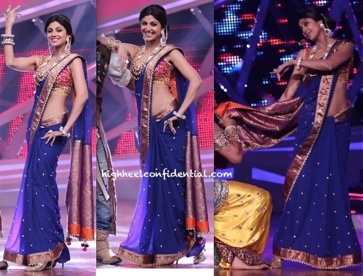 Wearing a Preeti S Kapoor sari, Shilpa taped a costume-drama themed episode of 'Nach Baliye'. A whole lot of jewelry from Anmol finished out her look.  If the look reads too costume-y, then it fits perfectly in to the theme of the show, don't you think? That aside, the sari looks on good on Ms. Shetty… Wish we had a non-blinged-out/non-forced-sexy-drape sighting of it!