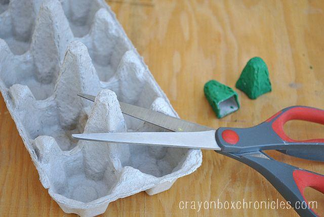 cutting egg carton to make eye holders
