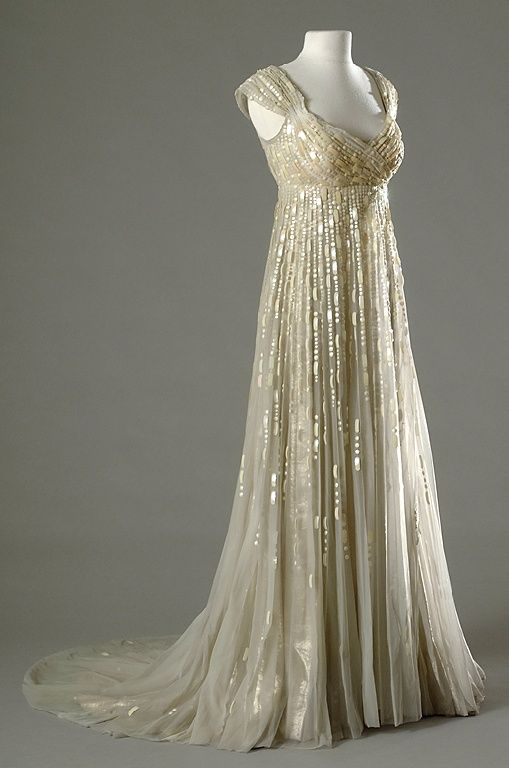 """Empire costume worn by Merle Oberon as Joséphine de Beauharnais in the 1954 film """"Désirée."""" As with most film costumes at the time, this is based less in historical fashion than in the styles of the day."""