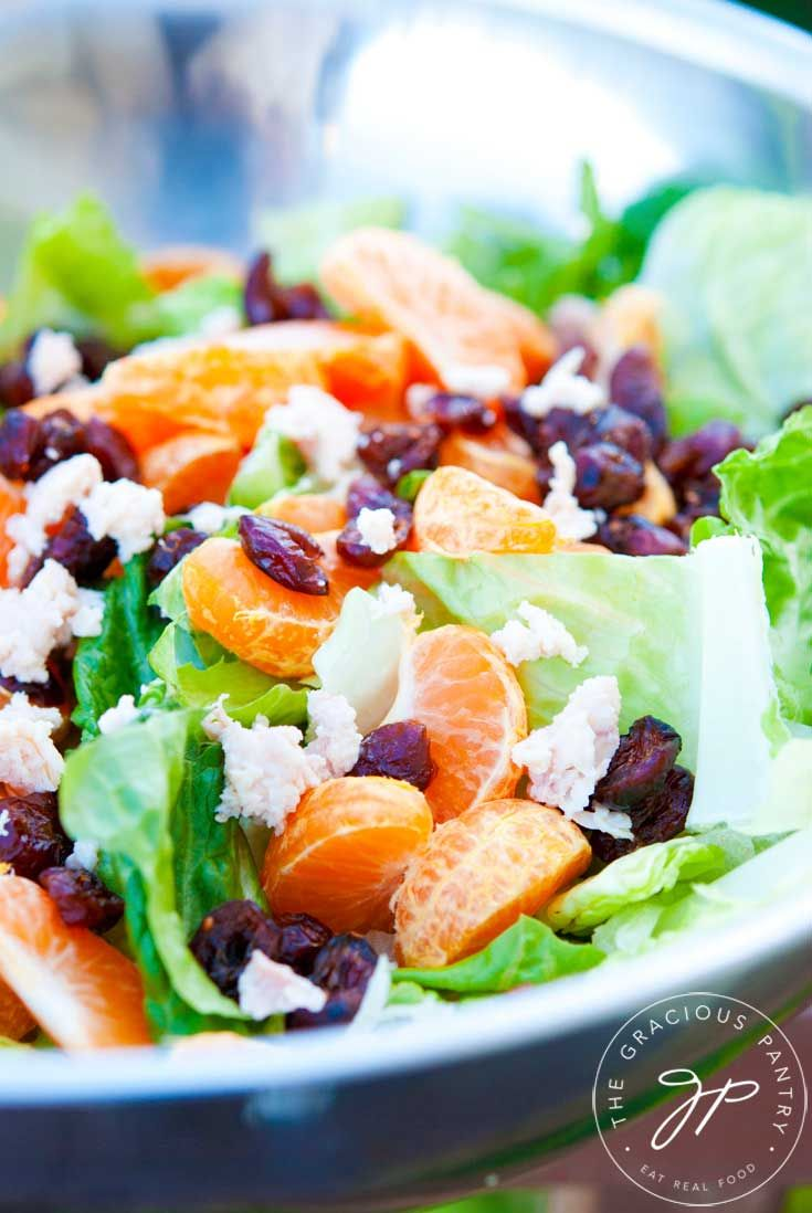 Clean Eating Mandarin Orange Chicken Salad With Dried Cranberries is a delicious way to enjoy a salad for lunch or dinner. This one is crazy delicious!!