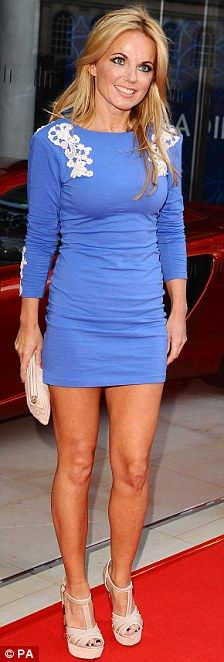 Geri Halliwell in a a pretty powderblue minidress with white lace detailing on the shoulders.