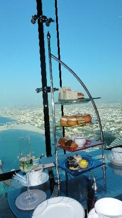 High Tea_With magical view from the Sky Bar_Dubai. approx £160 for 2 - book in advance via website note dress code http://www.jumeirah.com/Hotels-and-Resorts/Destinations/Dubai/Burj-Al-Arab/Restaurants-And-Nightlife/Skyview-Bar/