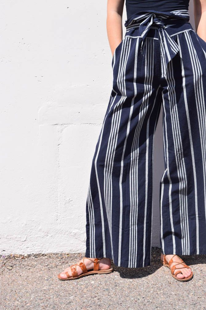 a high-waisted wide-leg pant with a paperbag waist tie. featured here in ace's custom yarn dye woven selvedge fabric, a midweight structured singlecloth in a dark indigo with pale grey stripes. made i