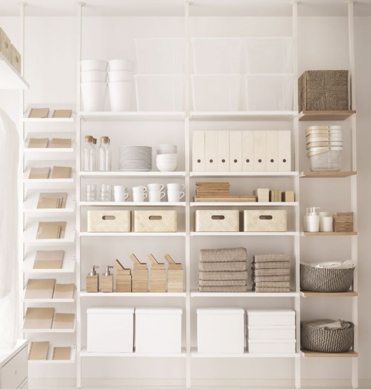 Instead of built in cabinets, set up these racks along one kitchen wall and add a sliding door