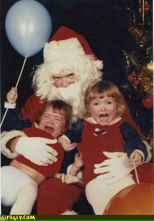 scary santa photos -they crack me up. here, let me teach my children about stranger danger and then toss them in the lap of an old drunk guy. trust me kids, not your intuition lol.