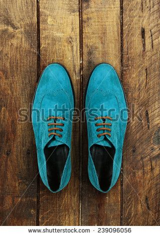 male shoes on a brown wooden background