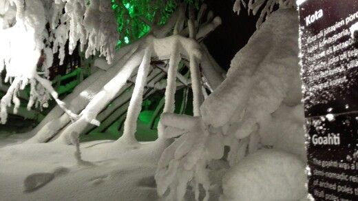 A goahti structure covered by snow.