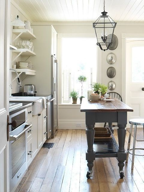 Bright cottage kitchen. Love the open shelves and stand alone island.
