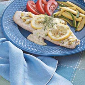 "Dilly Red Snapper Recipe -A light and creamy dill sauce lends lovely flavor to tender fish fillets. ""I like to serve this easy entree with a tossed salad and asparagus or a rice salad,"" says Sharon Semph of Salem, Oregon."