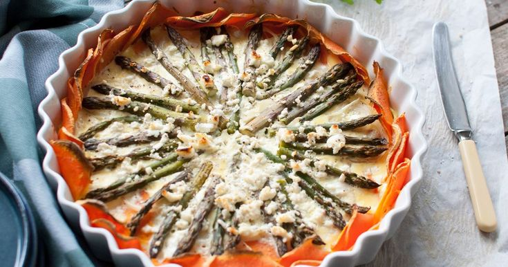 A delightful quiche with a deliciously simple shell of sliced sweet potato. Asparagus combined with crumbled cheese, onions and eggs make this a summery dish that can be served hot or cold.