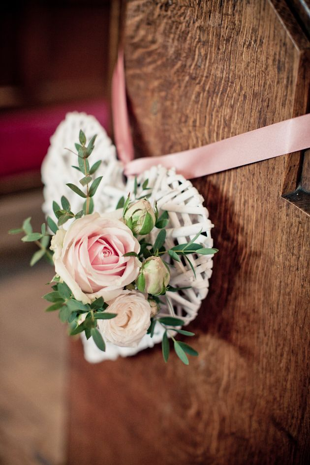 Hello gorgeous hanging aisle decor! White wicker hearts adorned with roses and tied with satin ribbon. // photo by Katy Lunsford Photography