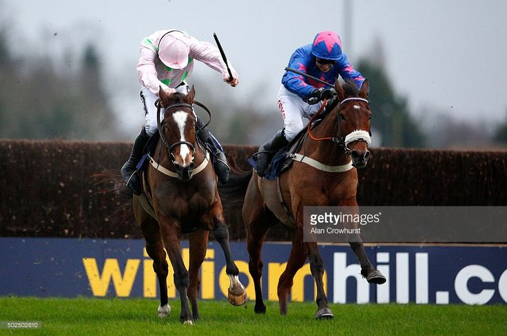 Paddy Brennan riding Cue Card (R) clear the last to win The William Hill King George VI Steeple Chase from Vatour and Ruby Walsh (L) at Kempton Park racecourse on December 26, 2015 in Sunbury, England.