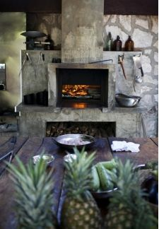 Rustic Fireplace Design Would be cool to have in house a a grill instead
