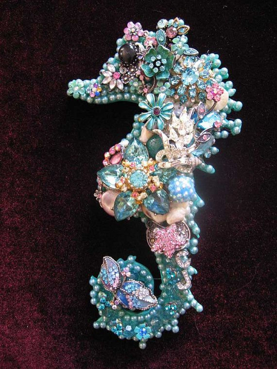 Nadia is a beautiful Seahorse hand layered with light ocean blue freshwater pearls, vintage rhinestone jewelry, pink flowers, crystals, sea shells and more. This bright and vibrant seahorse would look great in your beach house or ocean themed room. Nadia measures 7 x 4 inches.    Art Creations by CJ are one-of-a-kind vintage jewelry collage art & fashion creations ~ No two are ever the same! They can take days up to weeks to make due to the intricate detail I put into every creation. I st...
