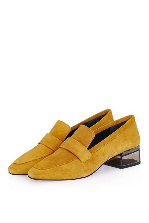 Win the shoe game in these unique mustard suede loafers, with an interest perspex heel. A quirky staple, team them with frayed jeans for a trending feel. #Topshop