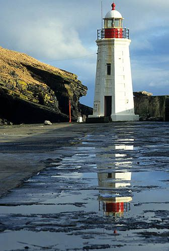 LYBSTER Lighthouse on the east coast of the Scottish Highlands.  Love the reflection in the water.