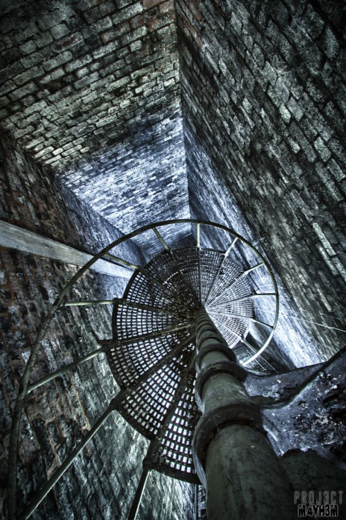 Spiral Staircase inside the Clipstone Colliery, Nottinghamshire, England. Abandoned in 2003.