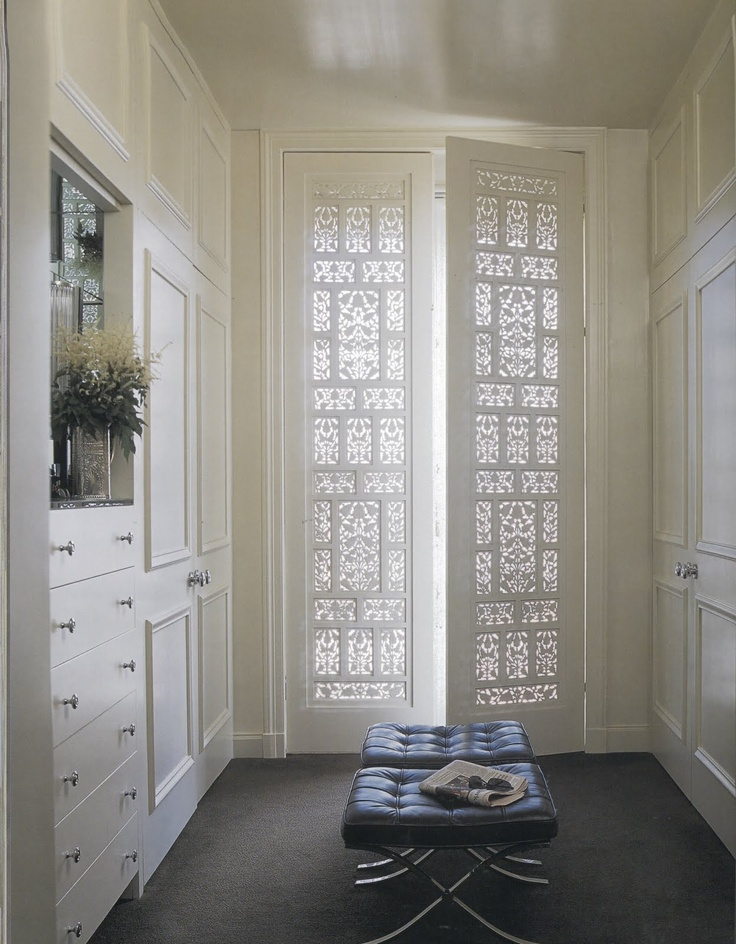 Fine detail screen doors - hall one side has the drawers, w/ tall countertop spot, and mirror above, other side has tall cabinet..