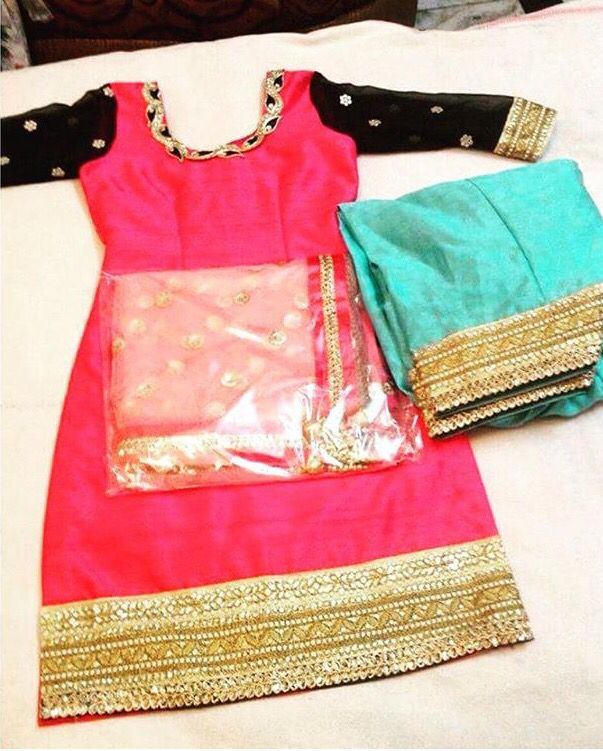 The teal and red color combination of this salwar kameez is gorgeous, but my favorite detail is the borders on the salwar and kameez.