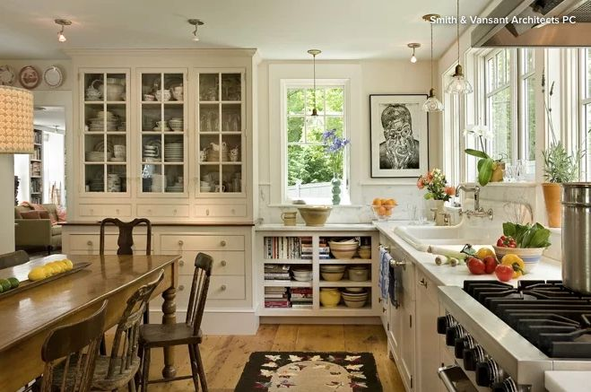 In a classic farmhouse kitchen, wall-mounted shelves and ...