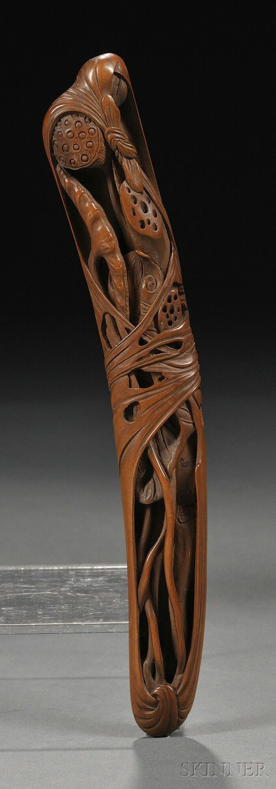 """Boxwood Sashi Netsuke, Japan, 19th century, elongated shape, carved in relief with lotus seed pods and leaves to the front, signed """"Shimizu…"""""""