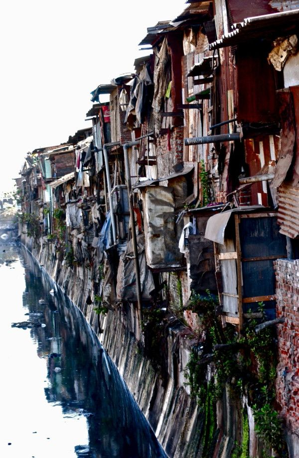 Sewage flows through Asia's largest slum, Dharavi. Ref pic for Paani